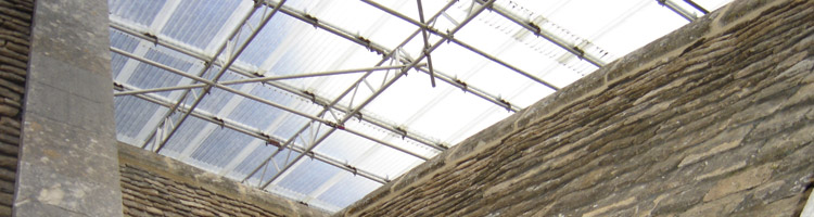 Scaffolding over slate roof restoration